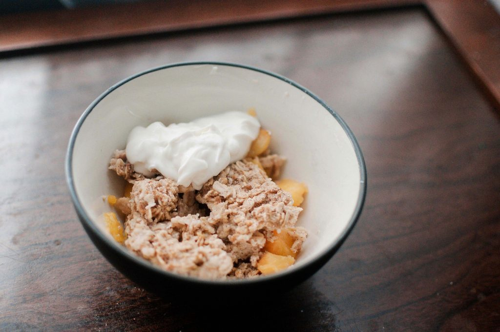 Peach crisp in bowl
