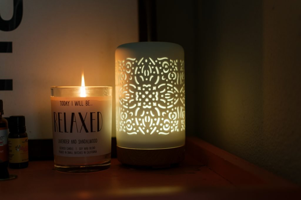 positive affirmation, candle, and essential oil diffuser