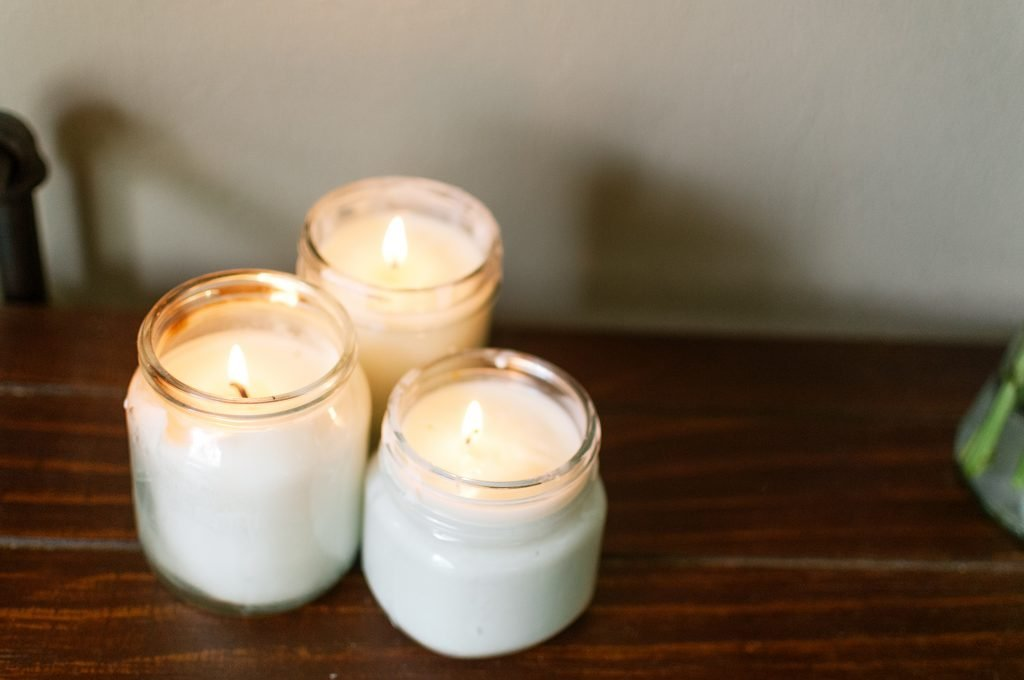 homemade aromatherapy candles in glass jars